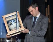 18 December 2015; Dublin's Alan Brogan, who recently announced his retirement, is presented with with an All Ireland Final Football, signed by his team mates, by the team captain Stephen Cluxton at the presentation of O'Byrne Cup. Allianz League, Leinster and All Irelaand Championship medals at Croke Park, Dublin. Picture credit: Ray McManus / SPORTSFILE