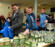 21 December 2015; Dublin footballers Paddy Andrews, goalkeeper coach Davy Byrne, and Conor McHugh as they help pack some 3,000 Christmas parcels for the homeless at the Capuchin Day Centre on Bow Street, Dublin. Picture credit: Ray McManus / SPORTSFILE