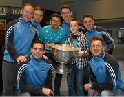 25 December 2015; Dublin footballers Paul Flynn, Bernard Brogan, Brian Fenton, Eoin Culligan, Cormac Costello, captain Stephen Cluxton and manager Jim Gavin with Leon Dooley, from Bray, Co. Wicklow, when they and the Sam Maguire visited patients of Beaumount Hospital on Christmas Day. Thirteen-year-old Leon recently underwent Neurosurgery for the treatment of epilepsy and is doing well. Beaumont Hospital, Beaumont Rd, Dublin.  Picture credit: Ray McManus / SPORTSFILE