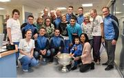 25 December 2015; Dublin footballers Paul Flynn, Bernard Brogan, Brian Fenton, Eoin Culligan, Cormac Costello, captain Stephen Cluxton, manager Jim Gavin and Dr. David Hickey with patients and staff of St. Damien's Ward when they and the Sam Maguire visited patients of Beaumount Hospital on Christmas day. Beaumont Hospital, Beaumont Rd, Dublin.  Picture credit: Ray McManus / SPORTSFILE
