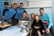 25 December 2015; Dublin footballers Paul Flynn, Cormac Costello and Bernard Brogan with Ian O'Reilly, Karen and Leah, age 6, from Cavan Town, when they and the Sam Maguire visited patients of Beaumount Hospital on Christmas Day. Beaumont Hospital, Beaumont Rd, Dublin.  Picture credit: Ray McManus / SPORTSFILE