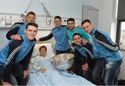 25 December 2015; Dublin footballers Paul Flynn, Bernard Brogan, Brian Fenton, Eoin Culligan, Cormac Costello, captain Stephen Cluxton with Orla Smith, from Bruskey, Cavan, when they and the Sam Maguire visited patients of Beaumount Hospital on Christmas Day. Beaumont Hospital, Beaumont Rd, Dublin.  Picture credit: Ray McManus / SPORTSFILE