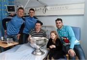 25 December 2015; Dublin footballers Paul Flynn, Cormac Costello and Bernard Brogan with Ian O'Reilly, and his daughter Leah, age 6, from Cavan Town, when they and the Sam Maguire visited patients of Beaumount Hospital on Christmas Day. Beaumont Hospital, Beaumont Rd, Dublin.  Picture credit: Ray McManus / SPORTSFILE