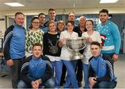 25 December 2015; Dublin footballers Paul Flynn, Bernard Brogan, Brian Fenton, Eoin Culligan, Cormac Costello, captain Stephen Cluxton and manager Jim Gavin with staff members Gabby Sullivan, Eva Christy, Ciara McBrien, Lavia Motherway and Martin Gill when they and the Sam Maguire visited patients St Damien's Ward in Beaumount Hospital on Christmas day. Beaumont Hospital, Beaumont Rd, Dublin.  Picture credit: Ray McManus / SPORTSFILE