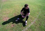 25  January 2001; Brian White, GAA Referee, relaxes on the field before the game between 1999 GAA All Stars v 2000 GAA All Stars, Eircell GAA Allstars Exhibtion game in Dubai, United Arab Emirates. Football. Picture credit; Ray McManus/SPORTSFILE