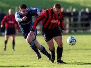 18 February 2001; Glen Crowe, Bohemians in action against Robert McAuley, UCD. UCD v Bohemians. eircom League Premier Division. Belfield Park. Soccer. Picture credit; David Maher/SPORTSFILE