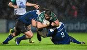 1 January 2016; Eoghan Masterson, Connacht, is tackled by Jack McGrath, left, and Marty Moore, Leinster. Guinness PRO12 Round 11, Leinster v Connacht. RDS Arena, Ballsbridge, Dublin. Picture credit: Ramsey Cardy / SPORTSFILE