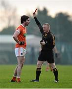 3 January 2016; Aaron Findon, Armagh, receives a red card from referee Barry Cassidy. Bank of Ireland Dr. McKenna Cup, Group C, Round 1, Armagh v Cavan. St Oliver Plunkett Park, Crossmaglen, Co. Armagh. Picture credit: Stephen McCarthy / SPORTSFILE