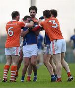 3 January 2016; Armagh players, from left, Ciarán McKeever, Aaron Findon and Charlie Vernon, Armagh, tussle with Niall Murray, Cavan. Bank of Ireland Dr. McKenna Cup, Group C, Round 1, Armagh v Cavan. St Oliver Plunkett Park, Crossmaglen, Co. Armagh. Picture credit: Stephen McCarthy / SPORTSFILE