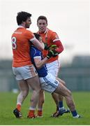 3 January 2016; Aaron Findon, Armagh, and Niall Murray, Cavan, tussle off the ball. Bank of Ireland Dr. McKenna Cup, Group C, Round 1, Armagh v Cavan. St Oliver Plunkett Park, Crossmaglen, Co. Armagh. Picture credit: Stephen McCarthy / SPORTSFILE