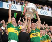 20 September 2009; Rathmore club-mates Tom O'Sullivan, left, and Aidan O'Mahony, Kerry, lift the Sam Maguire Cup. GAA Football All-Ireland Senior Championship Final, Kerry v Cork, Croke Park, Dublin. Picture credit: Ray McManus / SPORTSFILE
