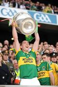 20 September 2009; Killian Young, Kerry, lifts the Sam Maguire cup. GAA Football All-Ireland Senior Championship Final, Kerry v Cork, Croke Park, Dublin. Picture credit: Ray McManus / SPORTSFILE