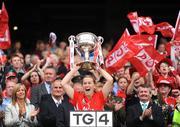 27 September 2009; Cork captain Mary O'Connor lifts the Brendan Martin cup. TG4 All-Ireland Ladies Football Senior Championship Final, Cork v Dublin, Croke Park, Dublin. Picture credit: Stephen McCarthy / SPORTSFILE