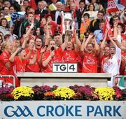27 September 2009; Cork captain Mary O'Connor and team-mates celebrate with the Brendan Martin cup. TG4 All-Ireland Ladies Football Senior Championship Final, Cork v Dublin, Croke Park, Dublin. Picture credit: Stephen McCarthy / SPORTSFILE