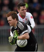 10 January 2016; Thomas Mallon, Derry, in action against Patrick Quinn, Tyrone. Bank of Ireland Dr. McKenna Cup, Group A, Round 2, Derry v Tyrone. Derry GAA Centre of Excellence, Owenbeg, Derry. Picture credit: Stephen McCarthy / SPORTSFILE