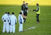 10 January 2016; Referee Patrick Maguire greets team captains Ollie Lyons, Kildare, right, and Alan Mulhall, Offaly, before the game. Bord na Mona O'Byrne Cup, Section B, Offaly v Kildare, O'Connor Park, Tullamore, Co. Offaly. Picture credit: Piaras Ó Mídheach / SPORTSFILE