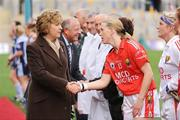 27 September 2009; President Mary McAleese is greeted by Cork captain Mary O'Connor before the game. TG4 All-Ireland Ladies Football Senior Championship Final, Cork v Dublin, Croke Park, Dublin. Picture credit: Brendan Moran / SPORTSFILE