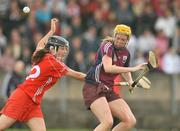10 October 2009; Sarah Dervan, Galway, in action against Liz Power, Cork. Gala All-Ireland Intermediate Camogie Championship Final Replay, Cork v Galway, McDonagh Park, Nenagh, Co. Tipperary. Picture credit: Diarmuid Greene / SPORTSFILE