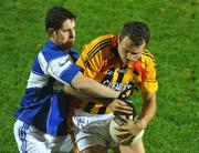10 October 2009; Jason Stokes, Dromcollogher Broadford, in action against Padraig Browne, Fr.Casey's. Limerick County Senior Football Final, Dromcollogher Broadford v Fr.Casey's, Gaelic Grounds, Limerick. Picture credit: Diarmuid Greene / SPORTSFILE