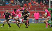 16 January 2016; Francis Saili, Munster, gets past the tackle of Julien Arias, Jonathan Danty, left, and Paul Williams, right, Stade Francais. European Rugby Champions Cup, Pool 4, Round 5, Munster v Stade Francais. Thomond Park, Limerick. Picture credit: Matt Browne / SPORTSFILE