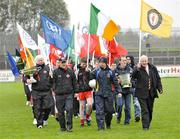 18 October 2009; Leading the 125 year celebrations parade prior to the game are, from left, Tony Fawl, Mickey Harte, Peter Canavan, Brian Dooher and Cuthbert Donnelly. Tyrone County Senior Football Final. Dromore v Ardboe, Healy Park, Omagh, Co. Tyrone. Picture credit: Michael Cullen / SPORTSFILE