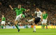10 October 2009; John O'Shea, Republic of Ireland, clears under pressure from Antonio Di Natale, Italy. 2010 FIFA World Cup Qualifier, Republic of Ireland v Italy, Croke Park, Dublin. Picture credit: Brendan Moran / SPORTSFILE