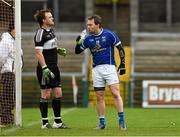 17 January 2016; Seanie Johnston, Cavan, gets a drink of water from Derry goalkeeper Thomas Mallon.Bank of Ireland Dr McKenna Cup, Semi-Final, Cavan v Derry. Athletic Grounds, Armagh. Picture credit: Philip Fitzpatrick / SPORTSFILE
