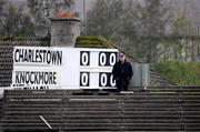 25 October 2009; The scoreboard attendant stands for the National Anthem ahead of the match. Mayo County Senior Football Final, Knockmore v Charlestown Sarsfields, McHale Park, Castlebar, Co. Mayo. Picture credit: Brian Lawless / SPORTSFILE