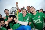 25 October 2009; Charlestown Sarsfields players, from left, Tony Mulligan, Brian O'Connell, Sean Lenehen, and Martin Mulvaney, celebrate with the cup after the match. Mayo County Senior Football Final, Knockmore v Charlestown Sarsfields, McHale Park, Castlebar, Co. Mayo. Picture credit: Brian Lawless / SPORTSFILE