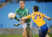 25 October 2009; Mark Caffrey, Charlestown Sarsfields, in action against Brian Ruttledge, Knockmore. Mayo County Senior Football Final, Knockmore v Charlestown Sarsfields, McHale Park, Castlebar, Co. Mayo. Picture credit: Brian Lawless / SPORTSFILE