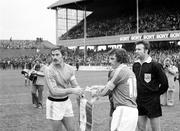 30 March 1977; Republic of Ireland captain John Giles, right, with France captian Christian Lopez and referee Mr. Linmayer, Austria, ahead of the game. World Cup Qualifier, Republic of Ireland v France, Lansdowne Road, Dublin. Picture credit: Connolly Collection / SPORTSFILE