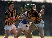18 February 2001; Brian Flannery, Waterford, is tackled by Jimmy Loogan and JP Corcoran, Kilkenny. Waterford v Kilkenny, National Hurling League, Walsh Park, Waterford. Picture credit; Aoife Rice/SPORTSFILE
