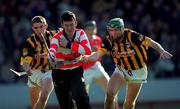 24 February 2001; Cork goalkeeper Donal Og Cusack is tackled by Kilkenny's Jimmy Coogan, right, and JP Corcoran. Cork v Kilkenny, National Hurling League, Pairc Ui Chaoimh, Cork. Picture credit; Ray McManus/SPORTSFILE