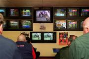 3 March 2001; Customers attending a Betting shop in Kildare Town watch on at screens as all sporting events in Ireland have been postponed as a precautionary measure against Foot and Mouth disease. Photo by Damien Eagers/Sportsfile