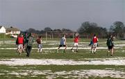 3 March 2001; Dublin based players from the Shamrock Rovers U16 and U14 squads during a training session at Dooder Valley Park in Dublin as all sporting events in Ireland have been postponed as a precautionary measure against Foot and Mouth disease. Photo by Damien Eagers/Sportsfile