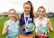 24 January 2016; Winner of the Girl's under 13 1500m race Ava O'Connor, centre, Emo/Rath AC, Co. Laois, with second placed Saoirse Crowe, left, St. Marys AC, Co Clare and third placed Orla Reidy, right,  St. Coca's AC, Co Kildare. The GloHealth National Master, Intermediate, Juvenile B & Juvenile Inter County Relay. Dundalk IT, Dundalk, Co. Louth. Picture credit: Tomás Greally / SPORTSFILE