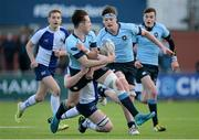 26 January 2016; Ian O'Kelly, St Michael's College, is tackled by Ben Ryan, St Andrew's College, as he off-loads to teammate Jack Dunne. Bank of Ireland Leinster Schools Senior Cup, 1st Round, St Andrew's College v St Michael's College, Donnybrook Stadium, Donnybrook, Dublin. Picture credit: Seb Daly / SPORTSFILE