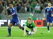 14 November 2009; Kevin Doyle, Republic of Ireland, in action against Patrice Evra, France. FIFA 2010 World Cup Qualifying Play-off 1st Leg, Republic of Ireland v France, Croke Park, Dublin. Picture credit: Paul Mohan / SPORTSFILE