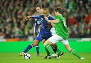 14 November 2009; Thierry Henry, France, in action against Richard Dunne, left, and Keith Andrews, Republic of Ireland. FIFA 2010 World Cup Qualifying Play-off 1st Leg, Republic of Ireland v France, Croke Park, Dublin. Picture credit: Matt Browne / SPORTSFILE