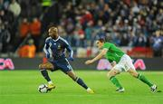 14 November 2009; Nicolas Anelka, France, in action against Keith Andrews, Republic of Ireland. FIFA 2010 World Cup Qualifying Play-off 1st Leg, Republic of Ireland v France, Croke Park, Dublin. Picture credit: Stephen McCarthy / SPORTSFILE