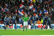 14 November 2009; Damien Duff, Republic of Ireland, stands dejected, as the French players celebrate Nicolas Anelka's goal. FIFA 2010 World Cup Qualifying Play-off 1st Leg, Republic of Ireland v France, Croke Park, Dublin. Picture credit: Stephen McCarthy / SPORTSFILE