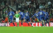 14 November 2009; Nicolas Anelka, second from left, France, celebrates after scoring his side's first goal with team-mates, as Damien Duff, Republic of Ireland looks on. FIFA 2010 World Cup Qualifying Play-off 1st Leg, Republic of Ireland v France, Croke Park, Dublin. Picture credit: David Maher / SPORTSFILE
