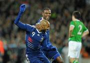 14 November 2009; Nicolas Anelka, France, celebrates with team-mate Eric Abidal, after scoring his side's first goal. FIFA 2010 World Cup Qualifying Play-off 1st Leg, Republic of Ireland v France, Croke Park, Dublin. Picture credit: Paul Mohan / SPORTSFILE