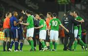 14 November 2009; Richard Dunne, Republic of Ireland, is restrained following the final whistle. FIFA 2010 World Cup Qualifying Play-off 1st Leg, Republic of Ireland v France, Croke Park, Dublin. Picture credit: Stephen McCarthy / SPORTSFILE