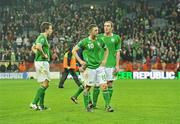 14 November 2009; Dejected Republic of Ireland players Sean St. Ledger, Robbie Keane and Richard Dunne, at the end of the game. FIFA 2010 World Cup Qualifying Play-off 1st Leg, Republic of Ireland v France, Croke Park, Dublin. Picture credit: David Maher / SPORTSFILE