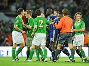14 November 2009; Keith Andrews, Republic of Ireland, and Alou Diarra, France square up after the final whistle. FIFA 2010 World Cup Qualifying Play-off 1st Leg, Republic of Ireland v France, Croke Park, Dublin. Picture credit: Matt Browne / SPORTSFILE