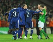 14 November 2009; Richard Dunne, Republic of Ireland, and goalkeeeping coach Alan Kelly are involved in an altercation with Bacary Sagne, France, following the final whistle. FIFA 2010 World Cup Qualifying Play-off 1st Leg, Republic of Ireland v France, Croke Park, Dublin. Picture credit: Stephen McCarthy / SPORTSFILE