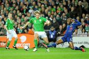14 November 2009; Kevin Doyle, Republic of Ireland, in action against William Gallas, France. FIFA 2010 World Cup Qualifying Play-off 1st Leg, Republic of Ireland v France, Croke Park, Dublin. Picture credit: Paul Mohan / SPORTSFILE