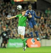 14 November 2009; Keith Andrews, Republic of Ireland, in action against Lassana Diarra, France. FIFA 2010 World Cup Qualifying Play-off 1st Leg, Republic of Ireland v France, Croke Park, Dublin. Picture credit: Stephen McCarthy / SPORTSFILE