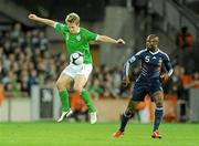 14 November 2009; Kevin Doyle, Republic of Ireland, in action against William Gallas, France. FIFA 2010 World Cup Qualifying Play-off 1st Leg, Republic of Ireland v France, Croke Park, Dublin. Picture credit: Stephen McCarthy / SPORTSFILE